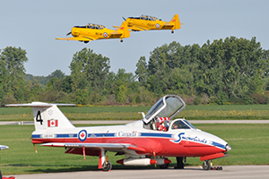 two harvards taking off with Snowbirds tutor jet underneath at Tillsonburg Regional Airport