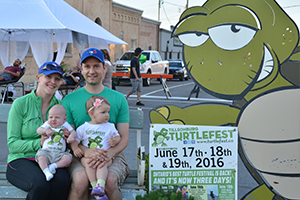 family at Turtlefest Block Party